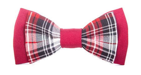 red bow tie with a black pattern on an isolated white background