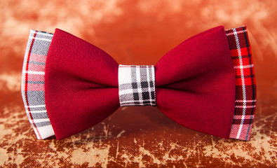 red bow tie with a black pattern
