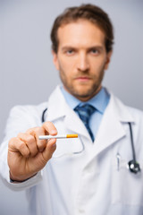 Doctor holding a sigarette