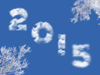 2015 written with clouds, snowy tree branches