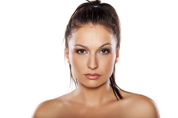 head shot of beautiful young woman on white background