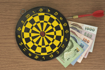 Dart, target, and Money