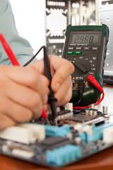 Technician repairing computer hardware in the lab .Small DOF
