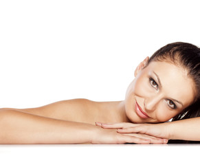 head shot of beautiful young woman, lying on white background