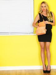 Young Business Woman Holding a Pink Handbag