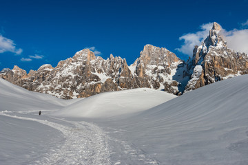 Hiker heading the Pale mountains in the snow, Dolomites