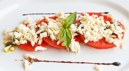 sliced tomato with sheep cheese