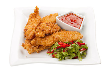 Fried chicken breast fillet in batter with vegetable salad on th