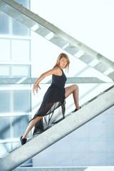 Contemporary ballet dancer posing on a urban staircase