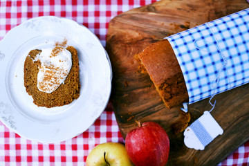 Pumpkin bread pound cake sliced with sour cream and cinnamon