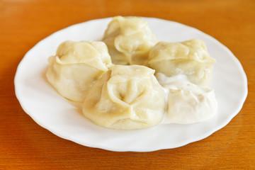 manti dumpling on white plate