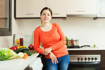 Portrait of  housewife  with fresh vegetables