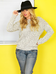 Attractive Young woman Wearing Jeans and a Jumper