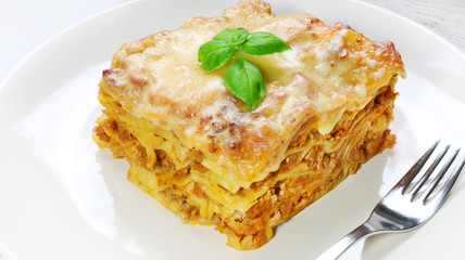 Lasagne with basil on white
