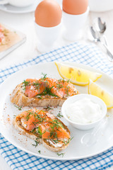 breakfast with bread, salted salmon and cream cheese, vertical