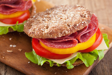 healthy sandwich with salami tomato pepper and lettuce
