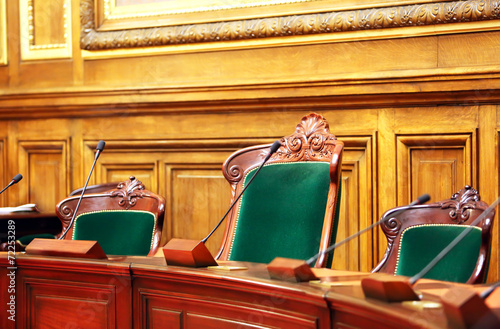 Empty vintage court's room with table,chairs and microphones. - 72253289