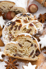 Christmas Stollen with dried fruit, assorted cookies and spices
