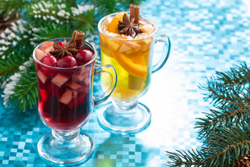 festive Christmas mulled wine and apple cider on blue background