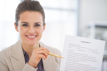 Portrait of happy business woman showing agreement