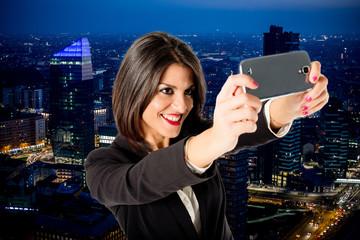 businesswoman selfie from skyscraper by night