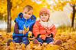 happy playful children in the autumn park