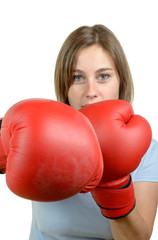 a pretty young girl with red boxing gloves