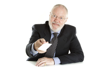 Elderly man with business card on white background