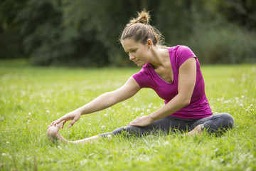 Gorgeous Young Woman in Outdoor Warm Up Exercise