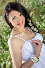 portrait of happy brunette woman