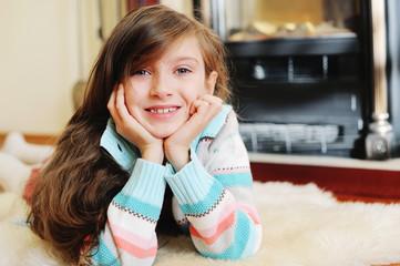 Kid  girl near fireplace