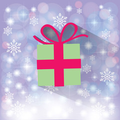 green gift box on snowflakes