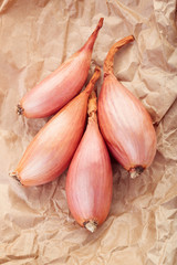 Shallot onions group on brown paper