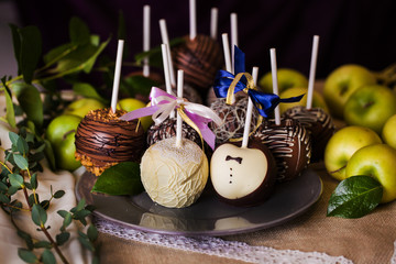 apples on a stick in the wedding day