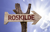 Roskilde wooden sign on a beautiful day