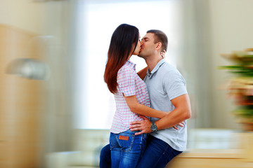 Portrait of a beautiful couple kissing at home