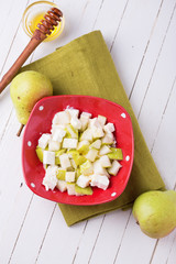 Fresh fruit salad with pears and cheese