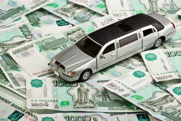 Toy car on money background