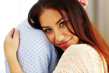 Closeup portrait of a happy couple hugging