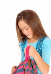 Girl looking in backpack.