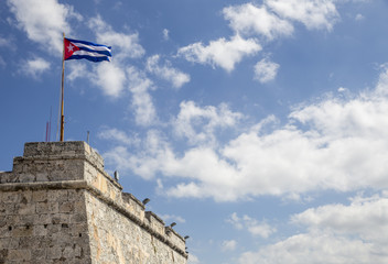 Cuban flag on the top of the Morro fortress in Havana, Cuba
