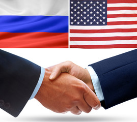 Representatives of Russia and the USA shake hands