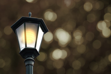 Street lamp with festive abstract bokeh background