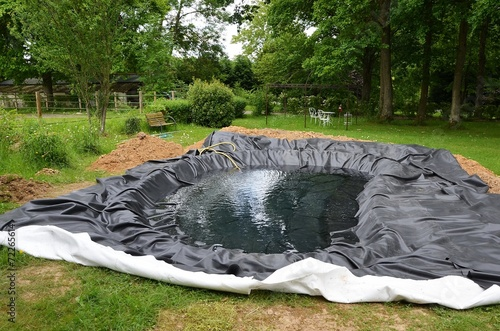 Construction d'un bassin de jardin - 72265614