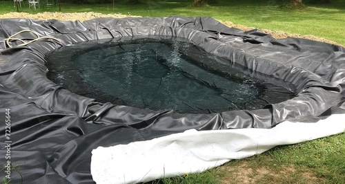 Construction d'un bassin de jardin - 72265644