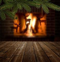 Weihnachtshirsche vor Kaminfeuer