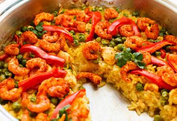 paella with shrimps, partially eaten