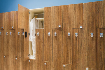 Bathrobe in the closet in the locker room spa center