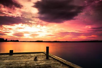 pier at lake and a beautiful sunset