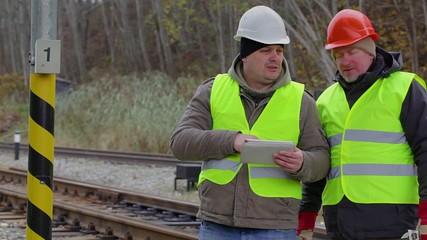 Railway engineer talking with worker